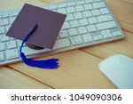 graducate cap on keyboard with... | Shutterstock . vector #1049090306