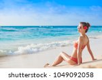 back view of woman in... | Shutterstock . vector #1049092058