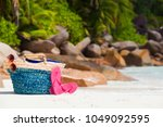straw bag  sun glasses and pink ... | Shutterstock . vector #1049092595