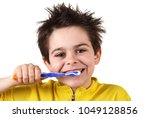 little boy is brushing his teeth | Shutterstock . vector #1049128856