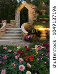 decorated backyard flower... | Shutterstock . vector #1049137196