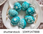 seven emerald easter eggs in a... | Shutterstock . vector #1049147888