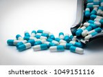 blue and white capsules pills... | Shutterstock . vector #1049151116