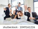 team having fun throwing paper... | Shutterstock . vector #1049161226