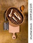 varied cooking utensils on a... | Shutterstock . vector #1049162105