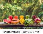 rainbow from smoothies.... | Shutterstock . vector #1049173745