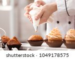 chef decorating tasty cupcakes... | Shutterstock . vector #1049178575