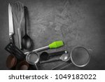 set of kitchen utensils on grey ... | Shutterstock . vector #1049182022