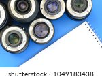 several photographic lenses and ... | Shutterstock . vector #1049183438