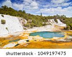 colourful silica terrace formed ... | Shutterstock . vector #1049197475