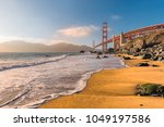 golden gate bridge at sunset... | Shutterstock . vector #1049197586