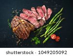 roasted rib eye steak with... | Shutterstock . vector #1049205092