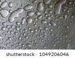 water drop on a steel...   Shutterstock . vector #1049206046