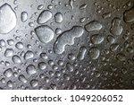 water drop on a steel...   Shutterstock . vector #1049206052