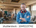 portrait of a man who owns a... | Shutterstock . vector #1049215742