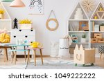 wooden box near pink table with ... | Shutterstock . vector #1049222222