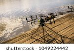 reels and rods at river or lake ...   Shutterstock . vector #1049224442