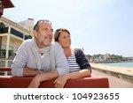 senior couple in seaside resort ...   Shutterstock . vector #104923655