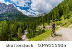 tourist cycling in cortina d... | Shutterstock . vector #1049255105