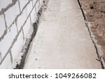 close up on house foundation... | Shutterstock . vector #1049266082