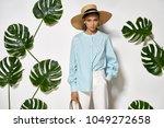 attractive girl is posing in a... | Shutterstock . vector #1049272658
