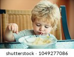 child eating delicious noodle ... | Shutterstock . vector #1049277086