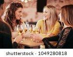 girlfriends drinking wine and... | Shutterstock . vector #1049280818