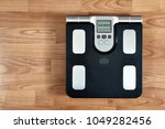 scale on wooden background top... | Shutterstock . vector #1049282456