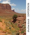 Small photo of Sentinel Mesa and West Mitten Butte in the pure horizon of Monument Valley Navajo Tribal Park, Arizona and Utah Border