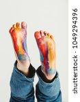 kid's feet painted in rainbow... | Shutterstock . vector #1049294396