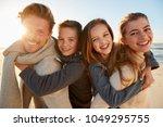 parents giving children... | Shutterstock . vector #1049295755