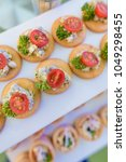 appetizer canapes with tuna on... | Shutterstock . vector #1049298455
