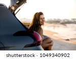 beautiful woman sitting in the... | Shutterstock . vector #1049340902