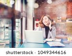 smiling business woman working... | Shutterstock . vector #1049344616