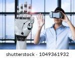 asian man wearing vr headset... | Shutterstock . vector #1049361932