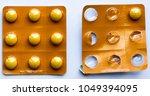golden pills on a white... | Shutterstock . vector #1049394095