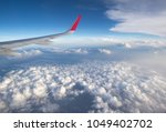 clouds and sky as seen through... | Shutterstock . vector #1049402702
