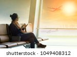 traveling woman sitting in... | Shutterstock . vector #1049408312