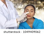 doctor nurse check face nose... | Shutterstock . vector #1049409062