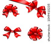 red bows  set  on a white   Shutterstock .eps vector #1049410235