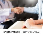 doctor shakes hands at medical... | Shutterstock . vector #1049412962