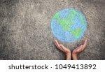 closeup hands holding earth... | Shutterstock . vector #1049413892