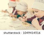 children decorating white... | Shutterstock . vector #1049414516