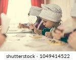children decorating white... | Shutterstock . vector #1049414522