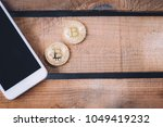 two coins of crypto currency... | Shutterstock . vector #1049419232