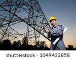 an electrical engineer wearing... | Shutterstock . vector #1049432858