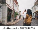 traveler backpacker use mobile... | Shutterstock . vector #1049434256