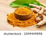 turmeric powder in wooden bowls ... | Shutterstock . vector #1049449898