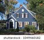 blue wood sided house | Shutterstock . vector #1049460182