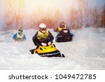 snowmobile races in snow.... | Shutterstock . vector #1049472785
